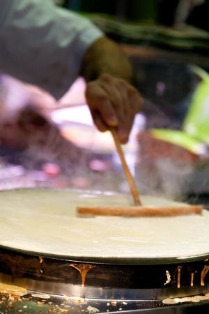 cooking crepe in Paris street cafe