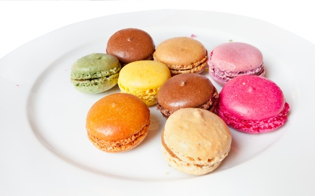 clse: Sweet french Macaroons on white plate clse up