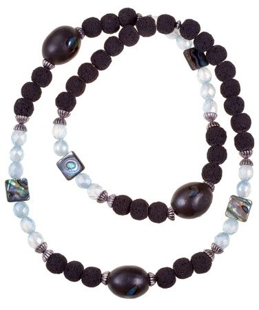 top view of necklace from glass bugles,ceramic balls and iridescentl stones isolated on white background photo