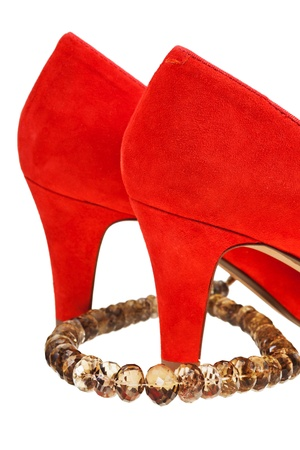 heelpiece: heels of woman red pumps shoe with necklace isolated on white background