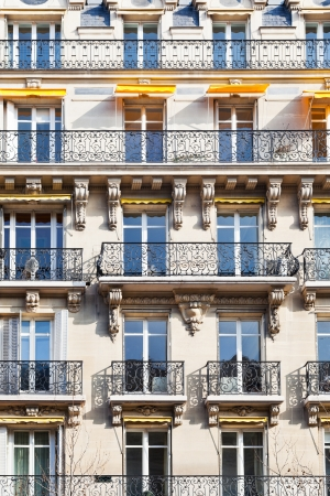 facacade of typical house with balcony in Paris, France