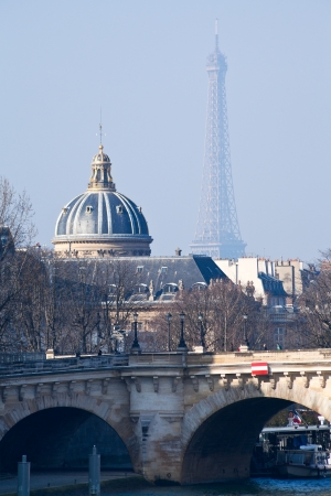 academie: view of Pont Neuf with Eiffel Tower and French Academy on background in Paris Editorial