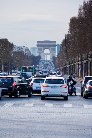 champs elysees: PARIS, FRANCE - MARCH 5: evening traffic on Avenues des Champs Elysees. The Champs-Elysees forms part of the Axe historique in Paris, France on March 5, 2013 Editorial