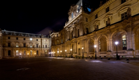 PARIS, FRANCE - MARCH 8: palais des arts of Louvre at night in Paris on March 8, 2013. The museum opened on 10 August 1793 with an exhibition of 537 paintings.