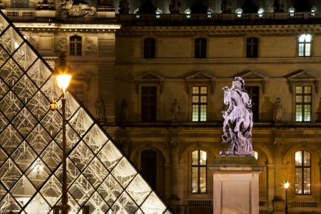 PARIS, FRANCE - MARCH 8: statue at Louvre courtyard in Paris, France on March 8, 2013. The pyramid and its underground lobby were inaugurated on 15 October 1988