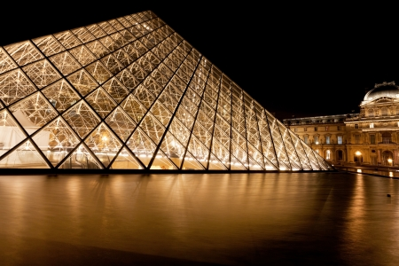 PARIS, FRANCE - MARCH 8: Pyramid of Louvre Museum at night. in 1983 architect I. M. Pei was proposed a glass pyramid to stand over a new entrance in the main court, in Paris on March 8, 2013