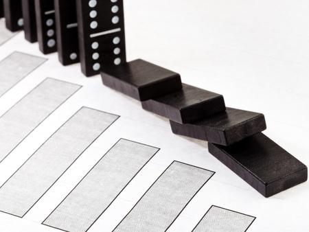 business concept - fallen domino and falling economy diagram Stock Photo