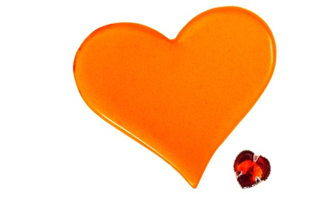 big red plastic heart and small red glass heart isolated on white background photo