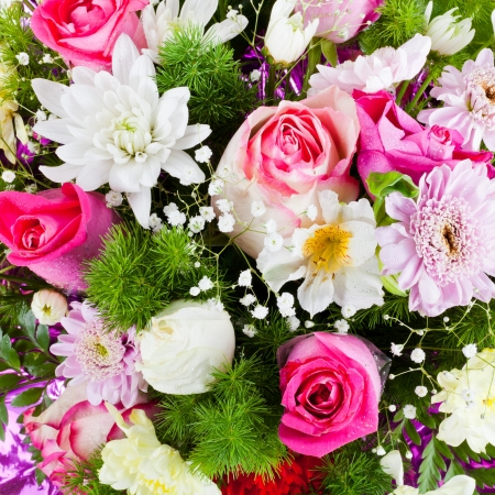 flower bouquet from chrysanths and tea roses close up photo