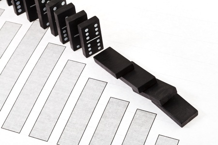 business concept - black domino and bad sales diagram Stock Photo