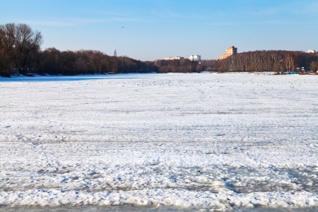 melting ice on frozen urban lake in early spring day Stock Photo - 19416637