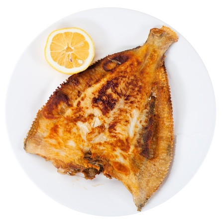 top view of fried sole fish on white plate isolatd on white background photo