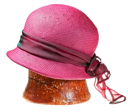 woman summer straw pink hat on wooden block isolated on white background photo