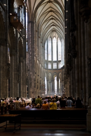 COLOGNE, GERMANY - JUNE 27: divine service in cathedral in Cologne, Germany on June 27, 2010. The Cathedral is Germanys most visited landmark, attracting an average of 20000 people a day