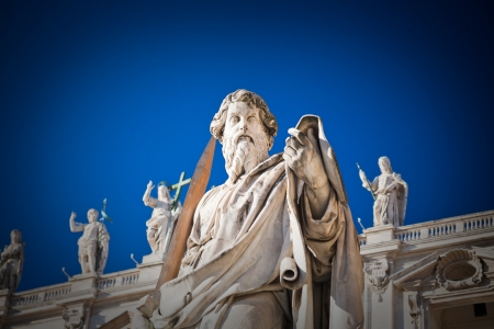 catholical: ROME, ITALY - DECEMBER 16: Statue of Apostle Paul in front of the Basilica of St. Peter in Vatican in Rome, Italy on December 16, 2010. The statue of St Paul was sculpted in 1838 by Adamo Tadolini