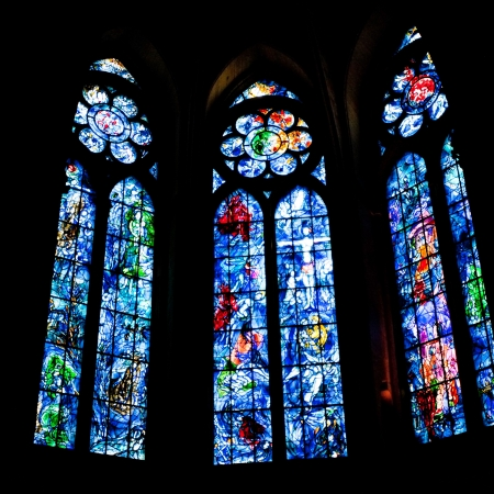 chagall: REIMS, FRANCE - JUNE 29: stained glass windows in Cathedral in Reims, France on June 29, 2010. Chapel stained glass windows were designed by Marc Chagall in 1974.