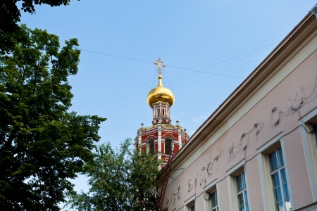 petrovka: golden cupola of St. Peter Monastery in Moscow, Russia Stock Photo
