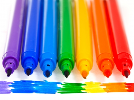 tips of seven rainbow colored felt pens close up photo