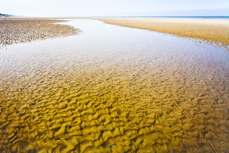 calais: low water at sand La Manche coastline in Normandy, France