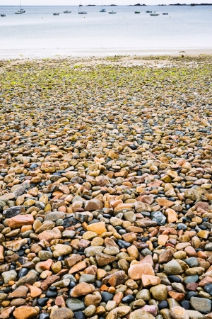 cotes d armor: granite pebble and boulder beach in Brittany, France Stock Photo