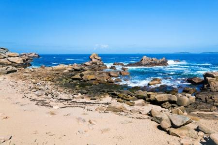 cotes d armor: Breton stone beach in sunny day Stock Photo