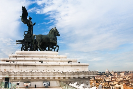 ROME, ITALY - DECEMBER 19: quadriga on top of Monument Vittorio Emanuele II and above view of Rome, Italy on December 19, 2010. Monument was made in 1911-1935.