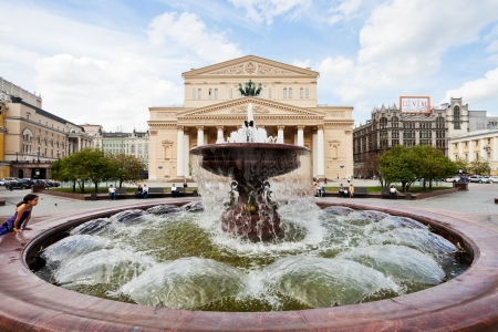 bove: MOSCOW, RUSSIA - MAY 25: Fountain on Theater square and Bolshoi Theater in Moscow, Russia on May 25, 2013. The square was designed in neoclassical style by Joseph Bove 1820s years