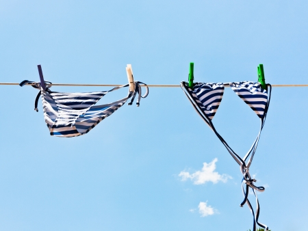 woman swimming bikini suit drying in wind photo