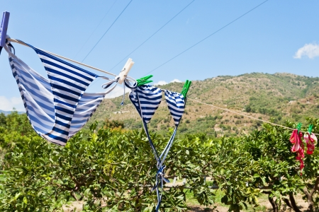 drying women swim suits outdoor on mountain hill in summer day photo