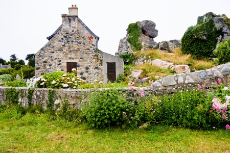 country house style: old stone house in traditional style in Brittany country, France Editorial