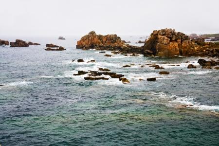 cotes d armor: rocky coastline of Atlantic ocean in Brittany in rainy day