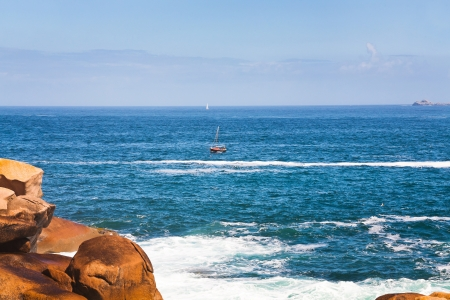 cote de granit rose: boat near Pink Granite Coast in Brittany in sunny day, France