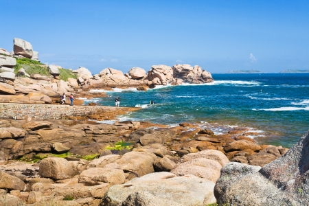cote de granit rose: tourists on Pink Granite Coast in Brittany in sunny day, France