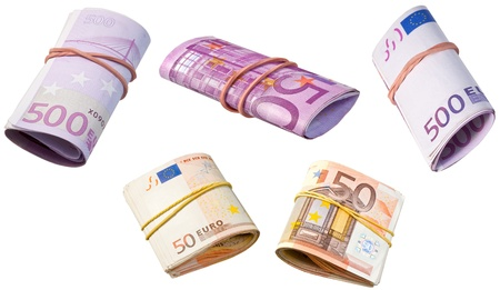 batch of euro: rolled into tube euro banknotes isolated on white background