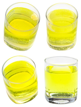 glass of yellow carbonated water with vitamin C isolated on white background Stock Photo - 20273542