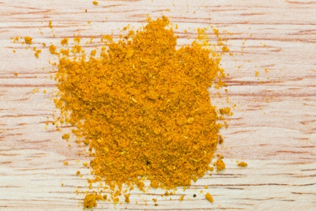 curry powder pinch on wooden board photo