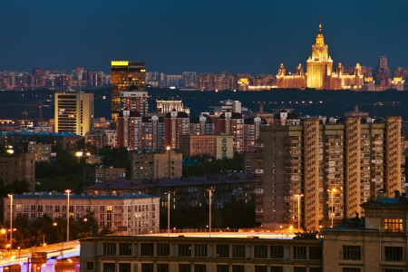 illuminated Moscow city in blue summer night photo