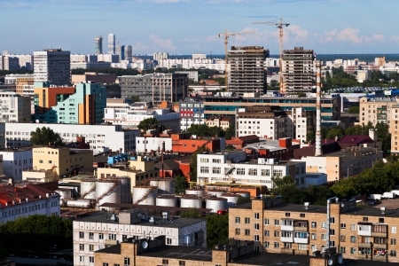 urban view with buildings under construction in Moscow in summer afternoon photo