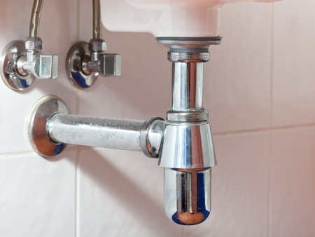 used metal sink siphon and drain closed up photo