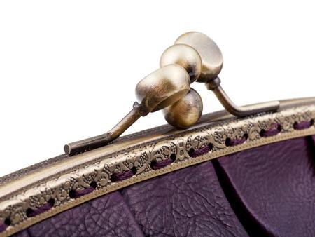 pochette: closed brass clutches of retro stile cjherry color handbag close up isolated on white background Stock Photo