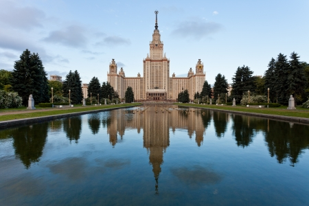university fountain: Moscow, Russia - June 22, 2013: panorama with Moscow State University and fountain pond in early morning