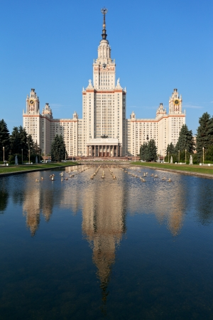 Moscow, Russia - June 30, 2013: main building of Moscow State University and fountain pond in summer day