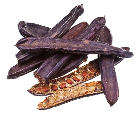 carob: dried carob pods isolated on white background