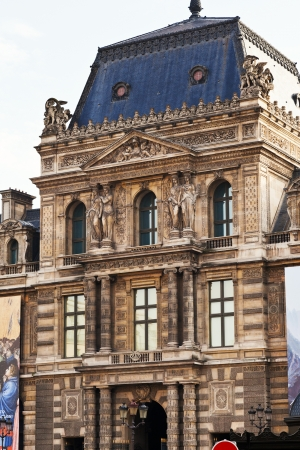 12th century: PARIS, FRANCE - MARCH 5: Louvre Museum from Place du Palais Royal. The museum is housed in the Louvre Palace which began as a fortress built in the late 12th century in Paris, France on March 5, 2013