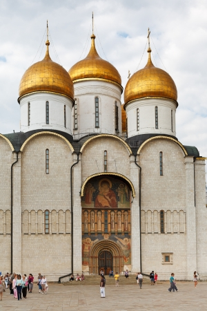 sobor: MOSCOW, RUSSIA - JULY 12: front view of Dormition cathedral from Sobor square in Moscow Kremlin, Russia on July 12, 2013. It is oldest fully preserved building of Moscow and main church Russian state
