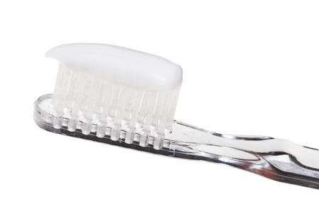 extruded: dentifricio estruso spazzolino vicino isolato su sfondo bianco Archivio Fotografico