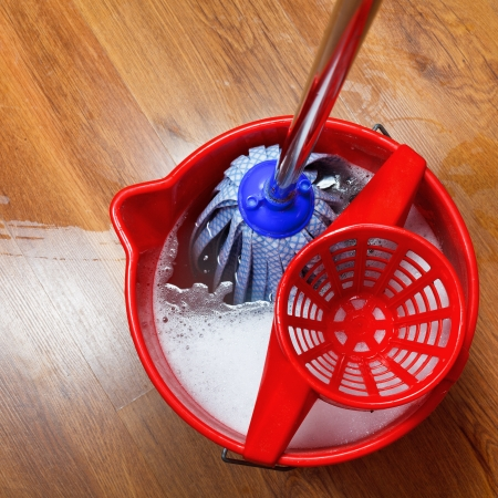 top view of mop in bucket with water for cleaning photo