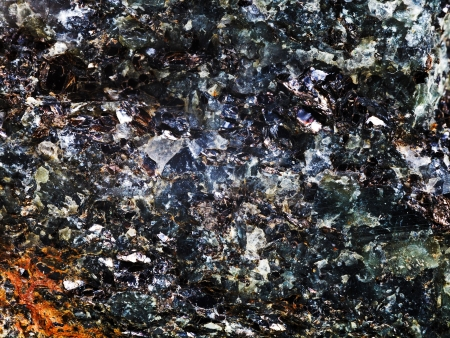 inclusions: background from rock with crystal and metallic inclusions