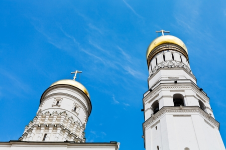 Ivan the Great Bell Tower and Assumption belfry in Moscow Kremlin in summer day photo