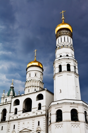 Ivan the Great Bell Tower and Assumption belfry in Moscow Kremlin over storm clouds photo